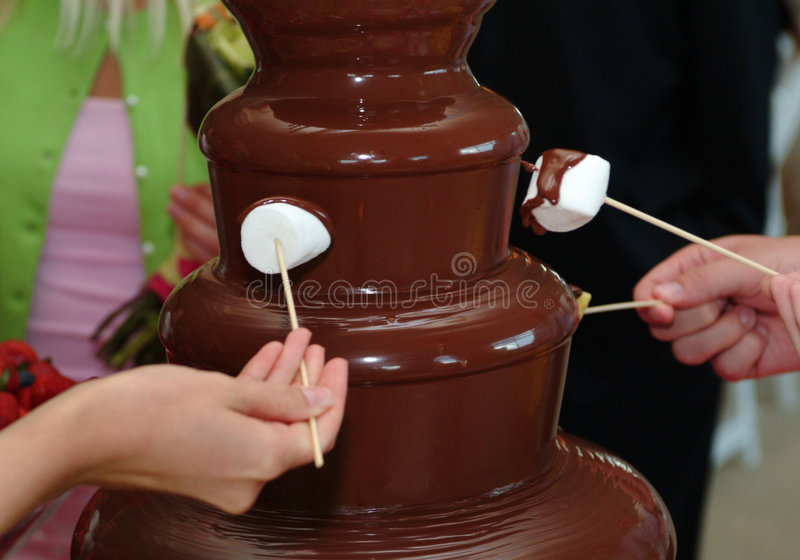 Chocolate fountain dipping royalty free stock photo