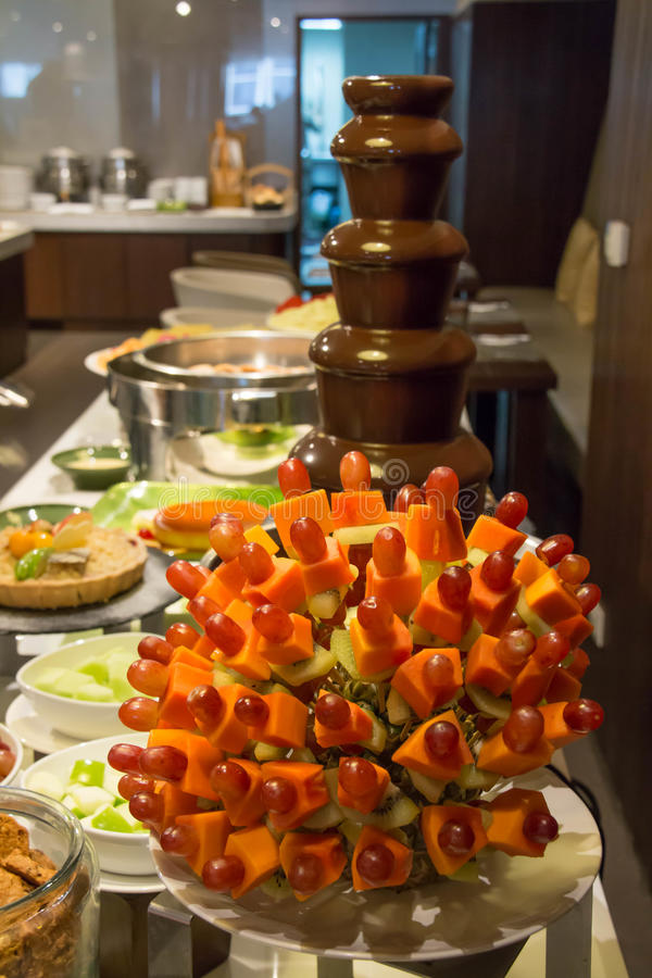 Chocolate fountain and mixed fruit skewer. A Chocolate fountain and mixed fruit skewer stock image