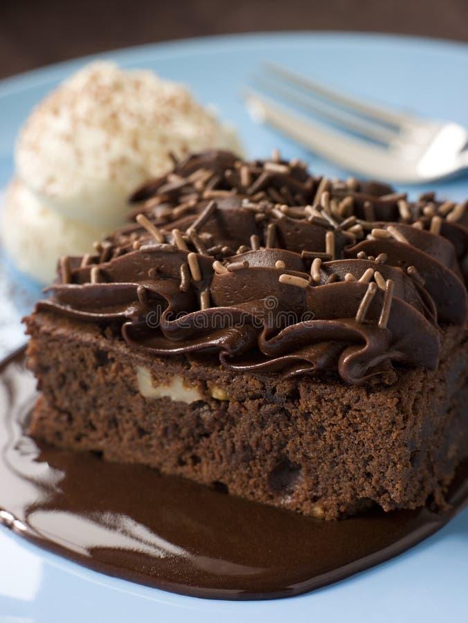 Chocolate Fudge Brownie With Chocolate sauce royalty free stock photo