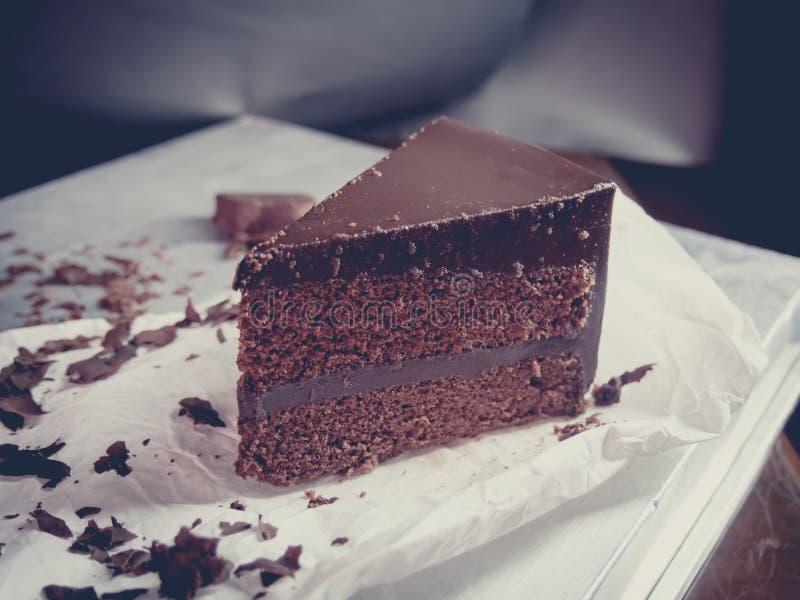 Chocolate fudge cake with vintage filter. Close up dark chocolate fudge cake with vintage filter,selective focus stock photos