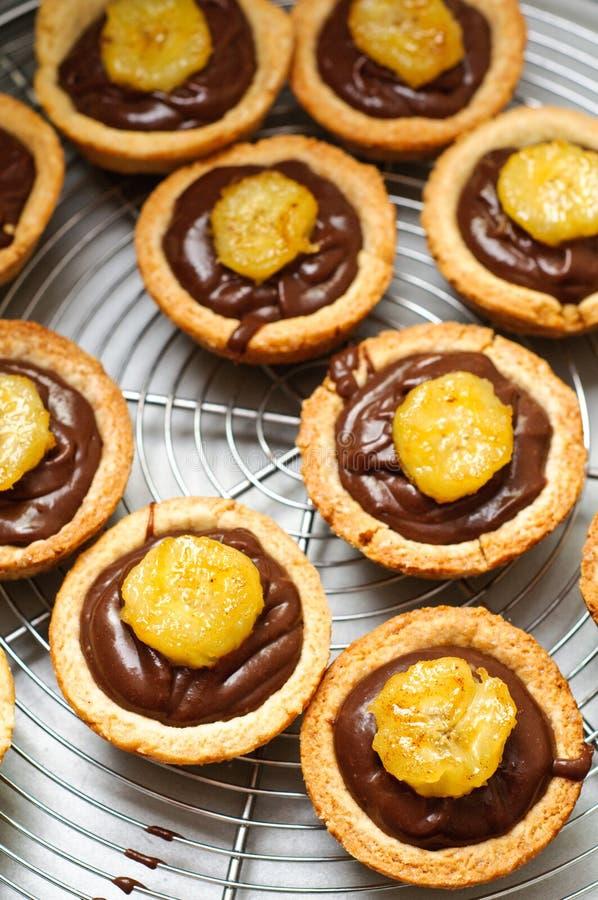 Chocolate ganache and banana tarts stock images