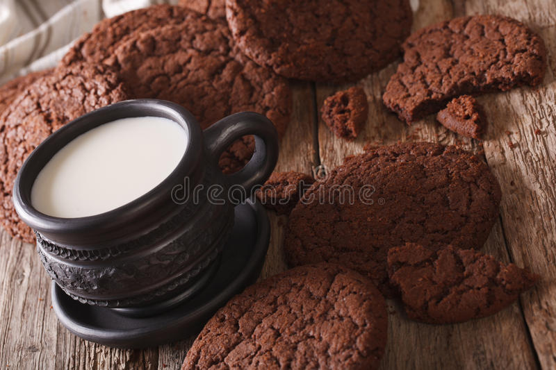 Chocolate gingerbread cookies and milk close-up. horizontal. Chocolate gingerbread cookies and milk on the table close-up. horizontal stock images