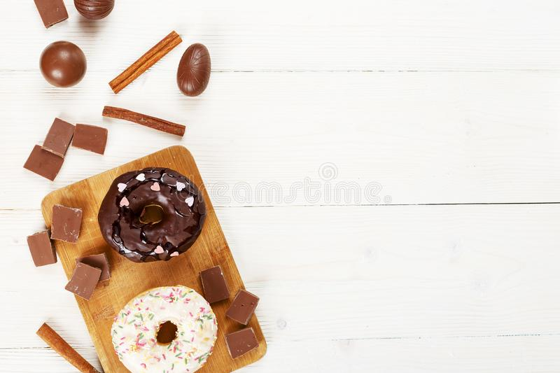 Donuts on a white table top view royalty free stock photos