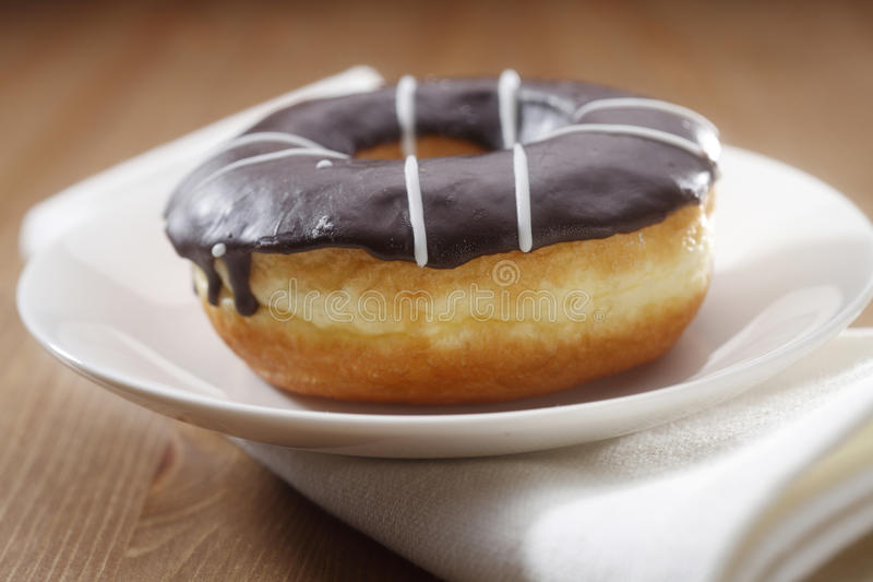 Chocolate-Glazed Doughnut stock image