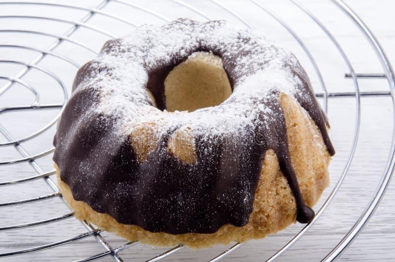 Chocolate gugelhupf on a baking rack stock images