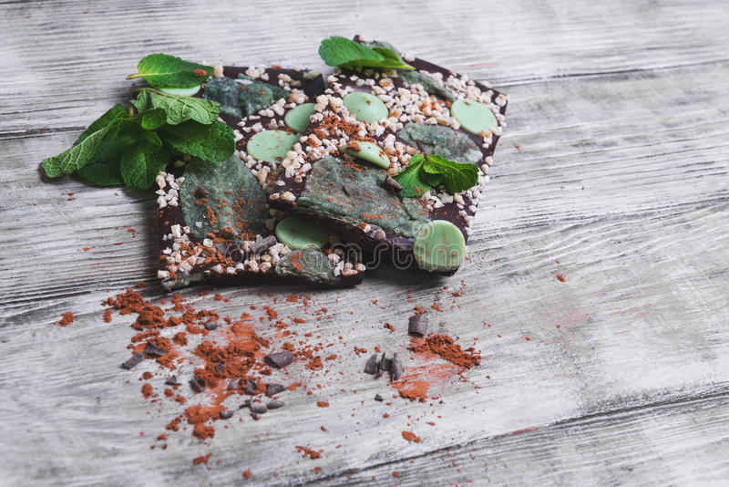 Chocolate, hand-made with mint leaves, candied violets, lemon ca royalty free stock image