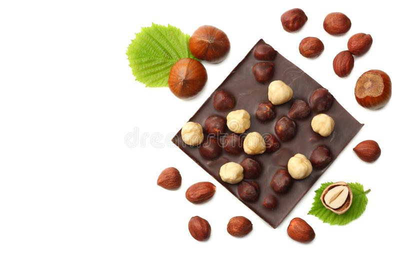 chocolate with hazelnuts and leaves isolated on white background. top view royalty free stock images