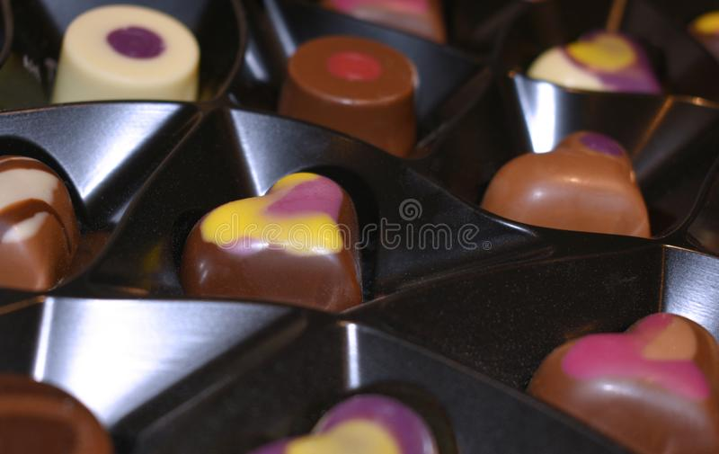 Chocolate heart. A box of heart shaped luxury chocolates / candies for Valentines Day stock image
