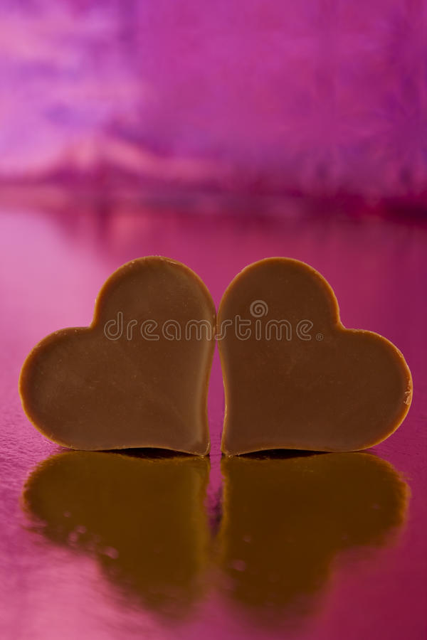 Chocolate Hearts On A Pink Background Royalty Free Stock Images