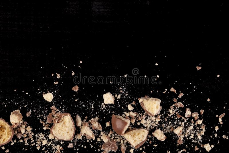 Chocolate treats smashed into pieces. Chocolate honeycomb crumbs with bit and peices broken up on the bottom of teh image stock photos