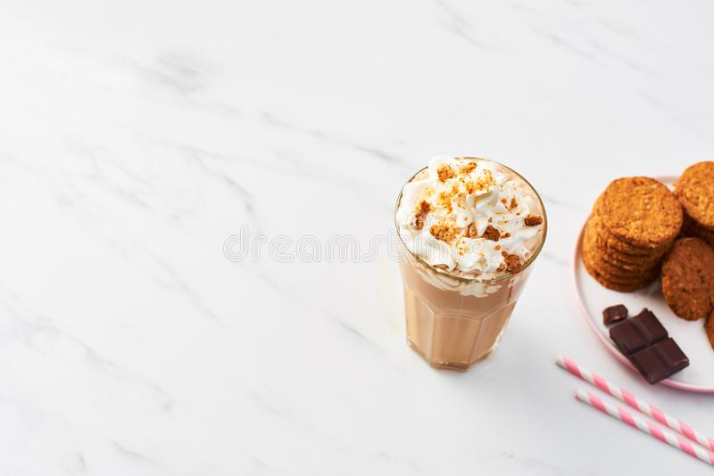 Chocolate ice coffee with whipped cream and cookies royalty free stock image