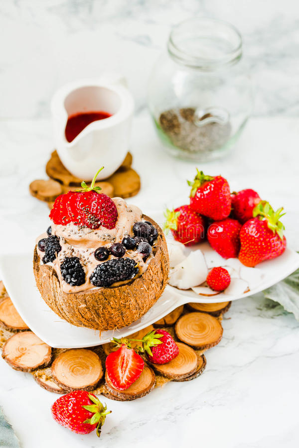 Download Chocolate Ice Cream With Berries On Coconut Cup.Healthy Vegetari Stock Photo - Image: 95079514