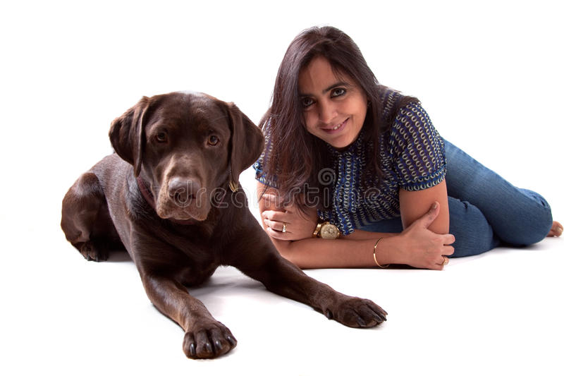 Chocolate Labrador Dog with his owner. Chocolate labrador retriever puppy with a beautiful Indian woman stock images