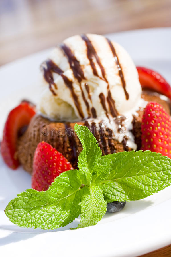 Chocolate lava cake with strawberries, mint and
