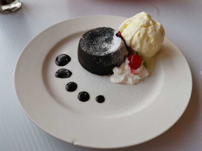 Chocolate lava cake with vanilla ice cream royalty free stock photos