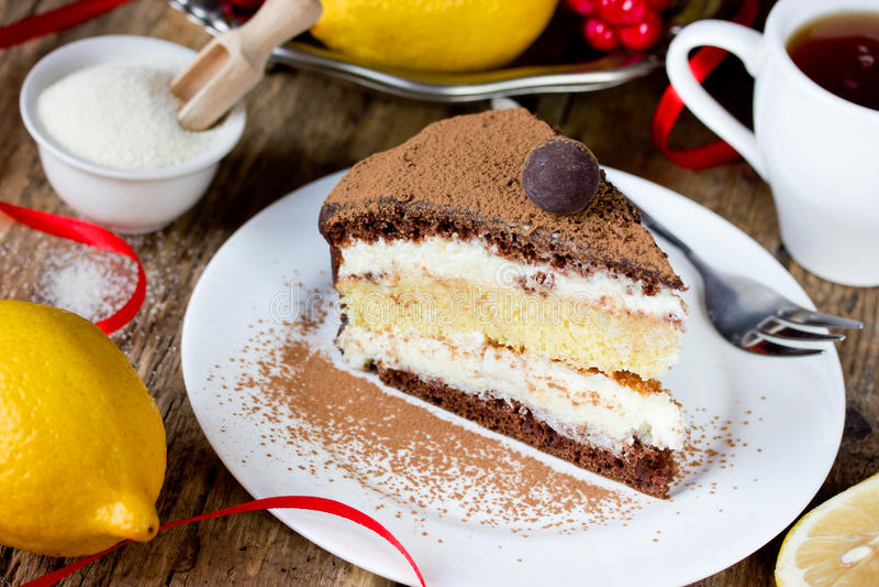 Chocolate lemon semolina cake , homemade layer cake with semolina citrus cream. Delicious dessert stock photography