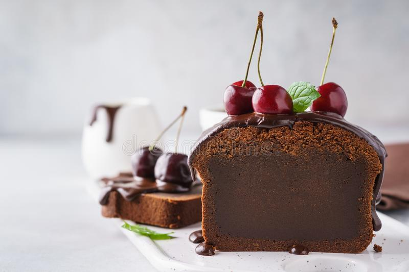 Chocolate loaf cake with cherries, mint and chocolate glaze royalty free stock image