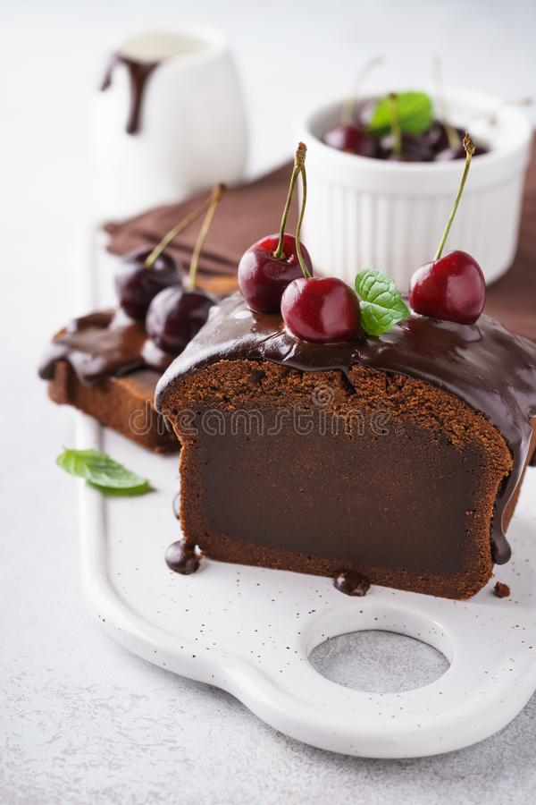 Chocolate loaf cake with fresh cherries and mint royalty free stock image