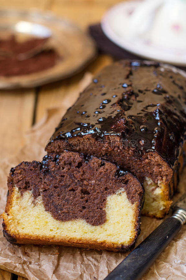Chocolate loaf marble cake with chocolate glazing. Chocolate vanilla loaf marble cake with chocolate glazing stock images