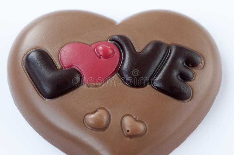 Chocolate love. Chocolate heart love on a white background royalty free stock photo
