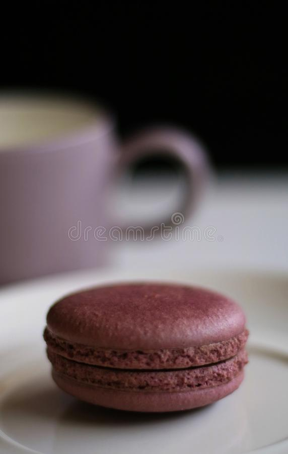 Chocolate Macron. And a cup of drink stock photos