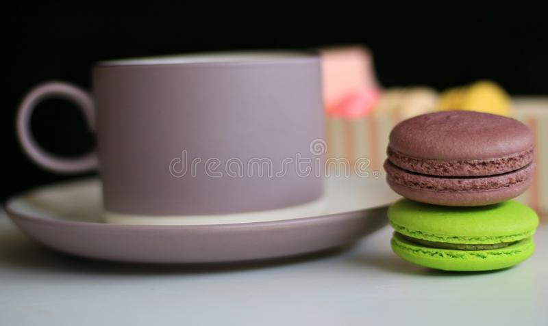 Chocolate Macron. And a cup of drink stock photo