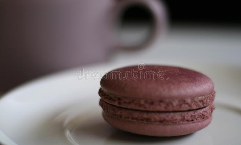 Chocolate Macron. And a cup of drink stock image
