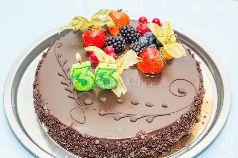 Chocolate mallow cake. For a 33rd birthday party royalty free stock images