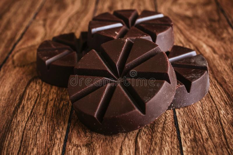 Chocolate mexicano, cinnamon sticks and mexican chocolate from oaxaca mexico on wooden in rustic style stock image