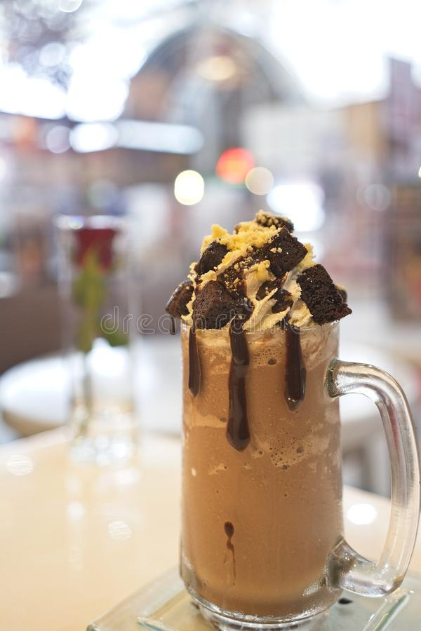 Chocolate milkshake with ice cream and whipped cream then topped with brownie and Chocolate sauce, served in Mason Jars royalty free stock photos