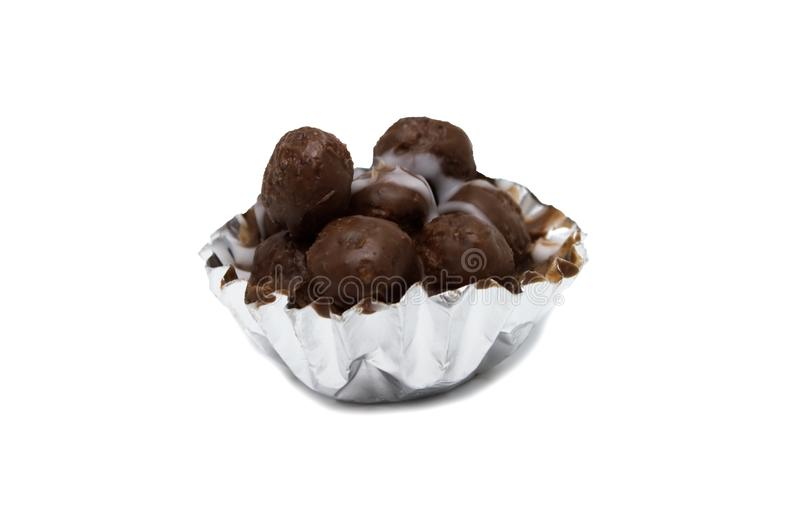 Chocolate mini balls inside of the cup. royalty free stock photography