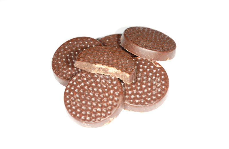 Chocolate mints isolated. Photograph showing chocolate mins isolated against white stock images