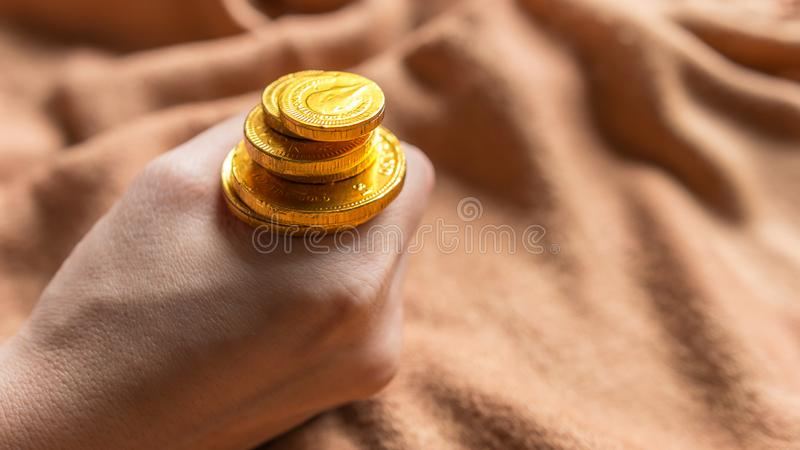 Chocolate money, Chocolate gold coins stock image