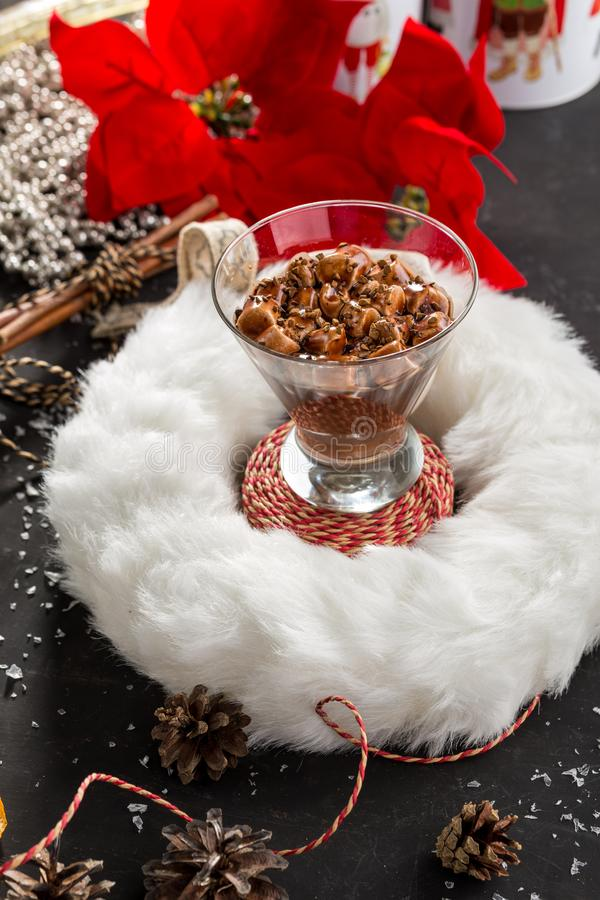 Chocolate mousse with marshmallow in portion glass on decorated christmas background stock images