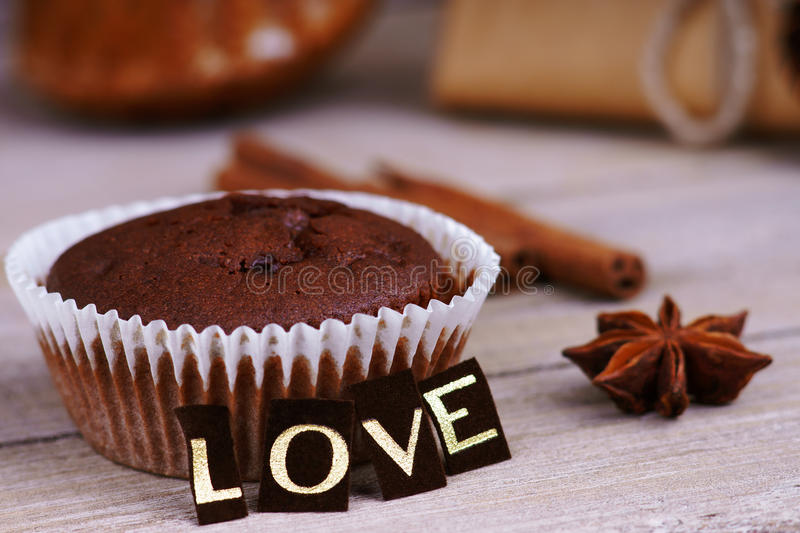 Chocolate muffin, anise and word love royalty free stock image