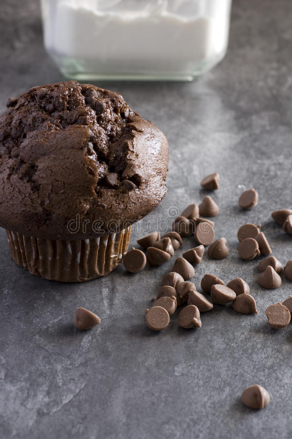Chocolate Muffin with Flour Jar and Chocolate Chips. Vertical Image stock images