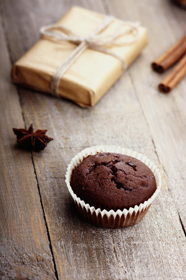 Chocolate muffin and gift box stock images
