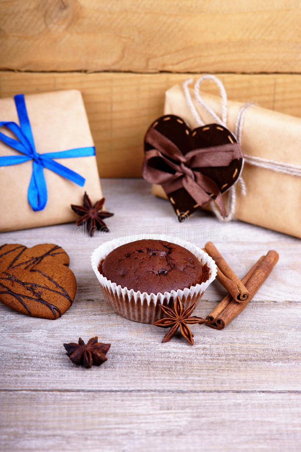 Chocolate muffin, gift boxes and heart shapes stock photo