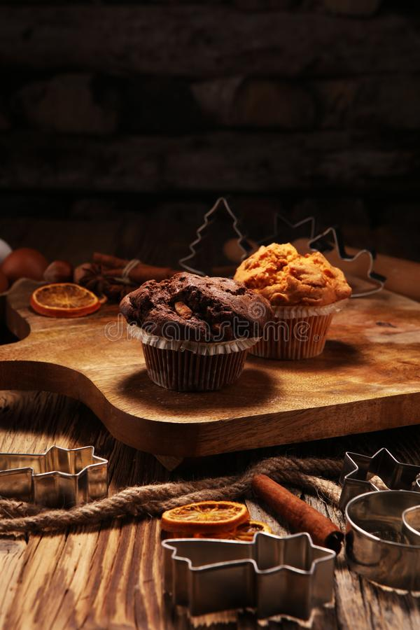 Chocolate muffin and nut muffin, homemade bakery wooden background stock images