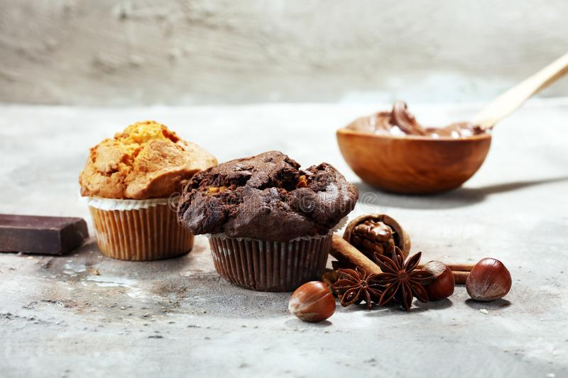 Chocolate muffin and nut muffin, homemade bakery on grey background stock images