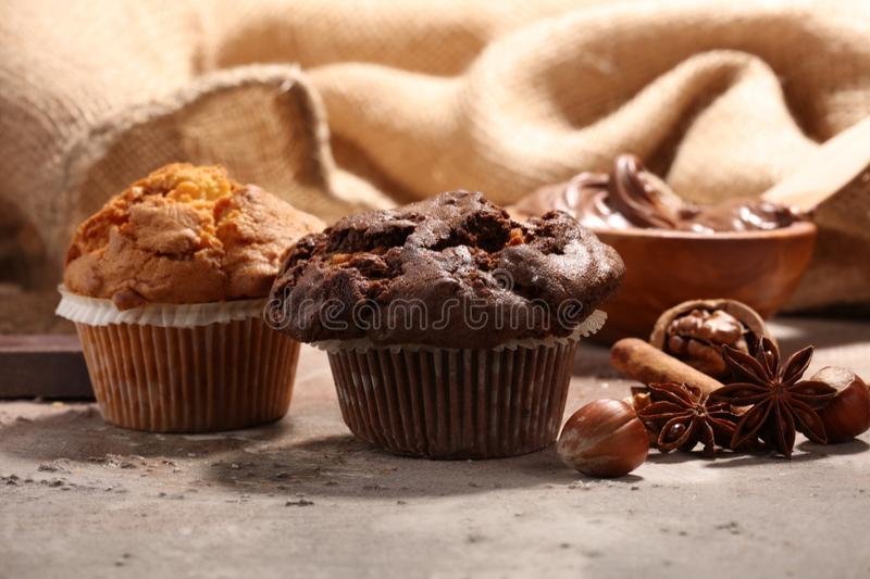 Chocolate muffin and nut muffin, homemade bakery on grey background royalty free stock image