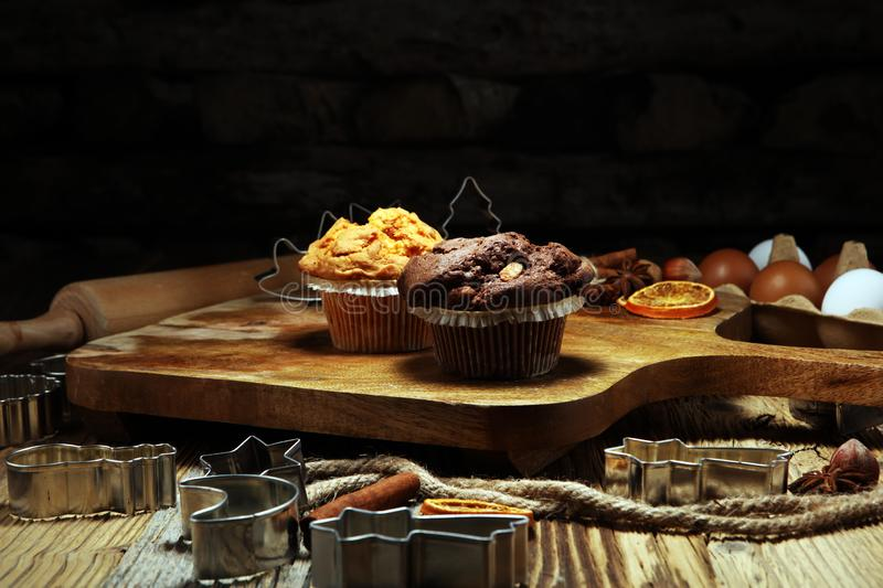 Chocolate muffin and nut muffin, homemade bakery wooden background royalty free stock photo