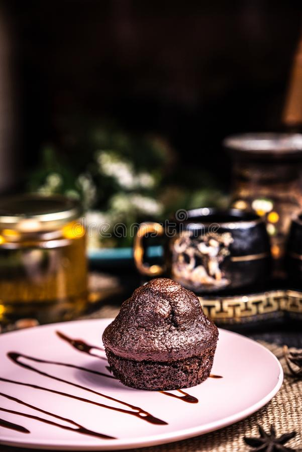 Chocolate muffin on a pink plate in a restaurant. Businessman breakfast royalty free stock photography