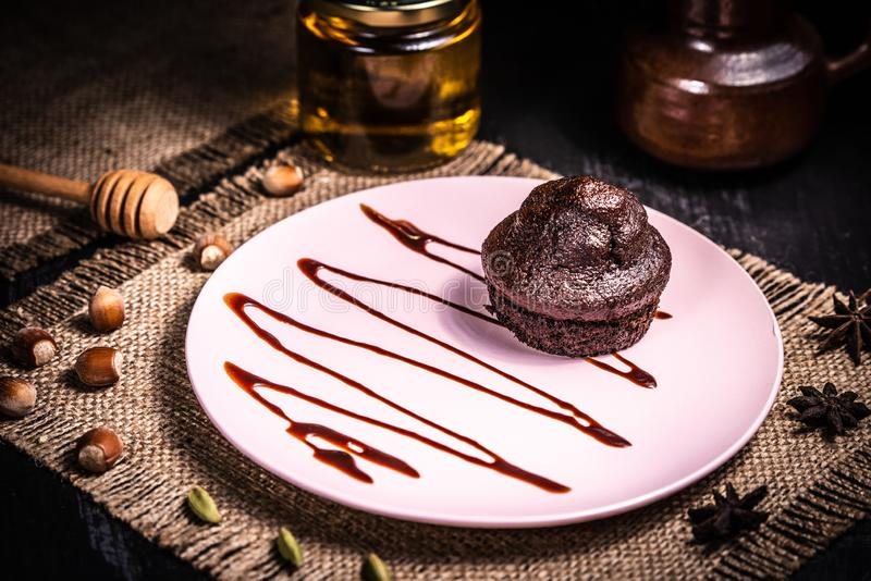 Chocolate muffin on a pink plate in a restaurant royalty free stock photography