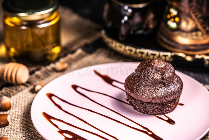 Chocolate muffin on a pink plate in a restaurant royalty free stock photos