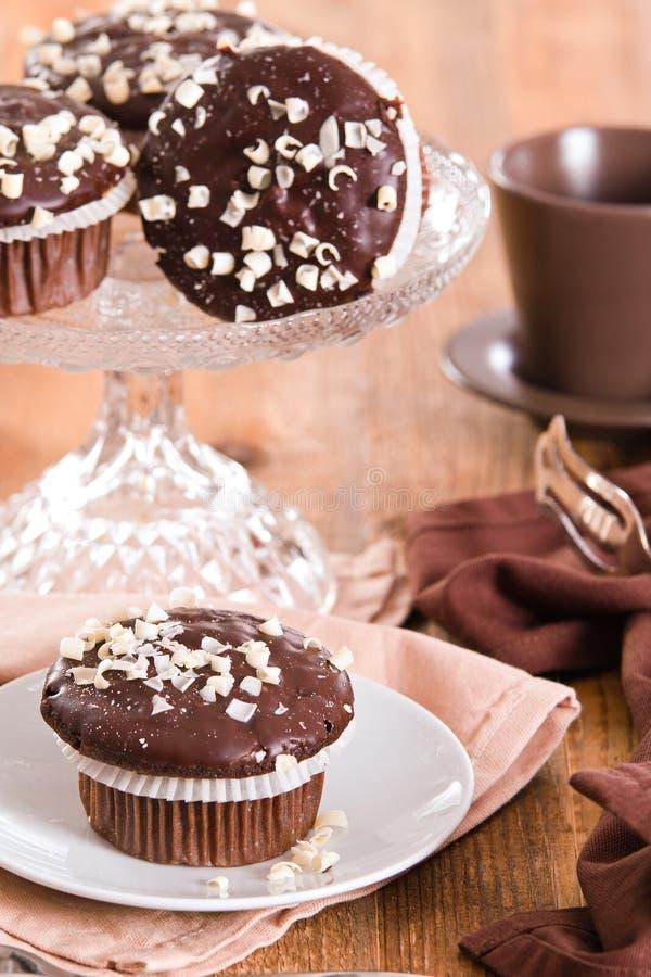 Chocolate muffin. Chocolate muffin on white dish stock photography