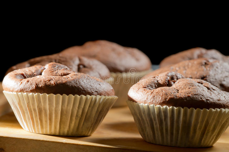 Chocolate muffin on wooden board stock photography