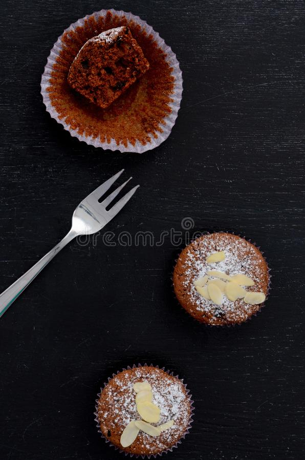 Chocolate muffins on dark blue background, top view. Chocolate muffins on dark blue background top stock photo