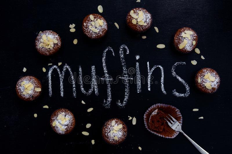 Chocolate muffins on dark blue background, top view. Chocolate muffins on dark blue background top stock photos