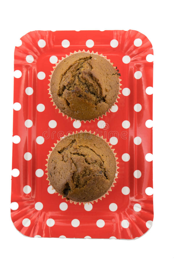 Chocolate muffins on the red plate on the white background royalty free stock photos